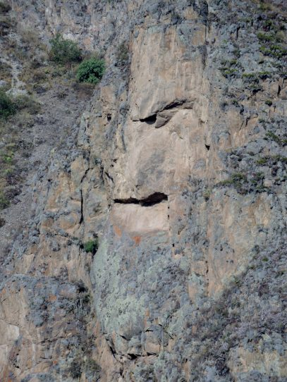 There is a huge face carved into the rock opposite.